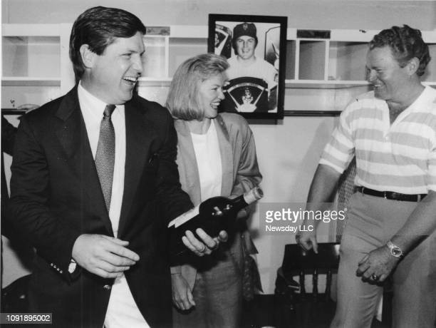 Tom Seaver and his wife Nancy share a joke with former Mets teammate Rusty Staub over a bottle of wine that he gave them at Shea Stadium in Flushing...