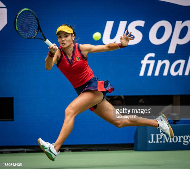 Emma Raducanu, GBR, hitting a forehand in the first set against Leylah Fernandez CAN, during their women's finals match at the UST,A Billie Jean King...