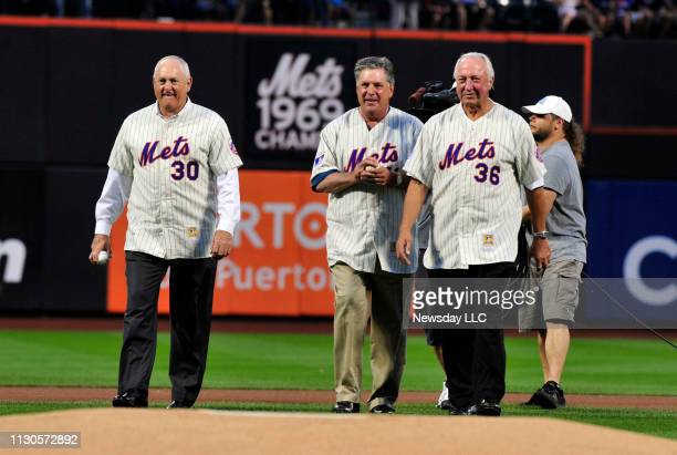 Former New York Mets pitchers Nolan Ryan Tom Seaver and Jerry Koosman walk to the pitcher's mound to throw out the first ceremonial pitch as the Mets...