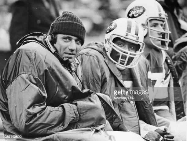 Joe Namath sits on the sidelines during the Jets vs Dolphins game at Shea Stadium in Flushing New York on November 7 1976