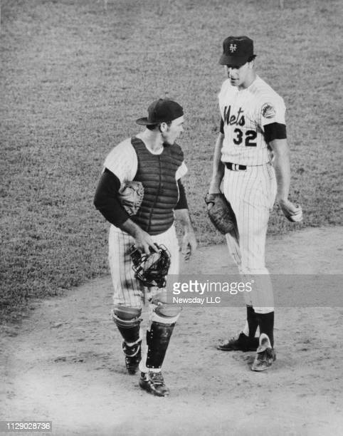 Mets catcher Jerry Grote talks with pitcher Jon Matlack on the pitcher's mound during the game against the Los Angeles Dodgers at Shea Stadium in...