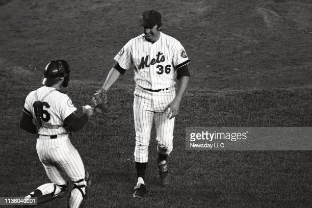 Mets catcher John Stearns runs out to greet Mets pitcher Jerry Koosman with the game ball after Koosman wins his 20th game of the season at Shea...