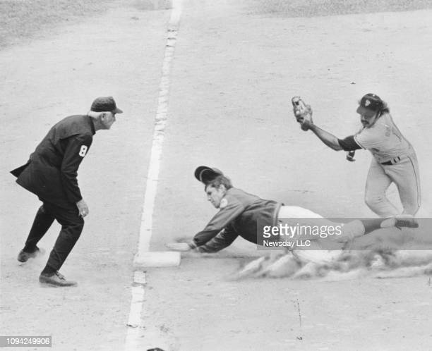 Mets pitcher Tom Seaver safely slides to 3rd base ahead of the tag by San Francisco Giants Steve Ontiveros at Shea Stadium in Flushing, Queens on...