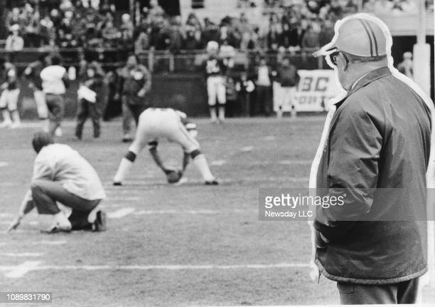 New York Jets head coach Weeb Ewbank watches as the team's center sets up for a field goal during practice at Shea Stadium in Flushing Queens on...