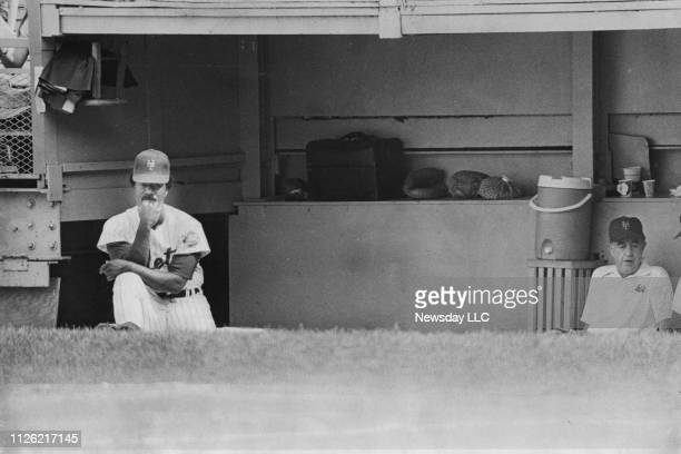 New York Mets Cleon Jones sits in silence at the far end of the dugout watching his team play the Houston Astros on July 20, 1975 at Shea Stadium in...