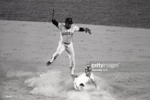 New York Mets Wayne Garrett slides into San Francisco Giants Tito Fuentes in an attempt to break up a double play on a ground ball hit by Mets Felix...