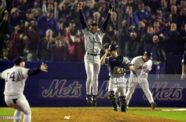 New York Yankees' Mariano Rivera jumps up in the air after Bernie Williams caught the last out to defeat the New York Mets 4-2 in game five of the...