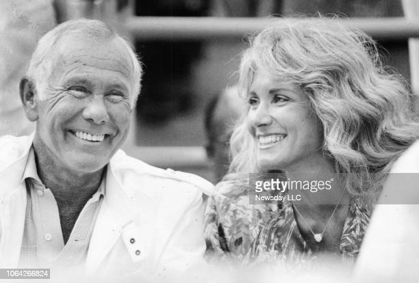 Talk show host Johnny Carson and his wife Alexis Maas watch a tennis match at the US Open Center in Flushing on September 11 1987