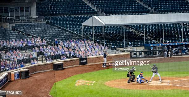 The New York Mets have cardboard cutouts of fans in the seats while playing the New York Yankees in a pre-season exhibition game at Citi Field in...