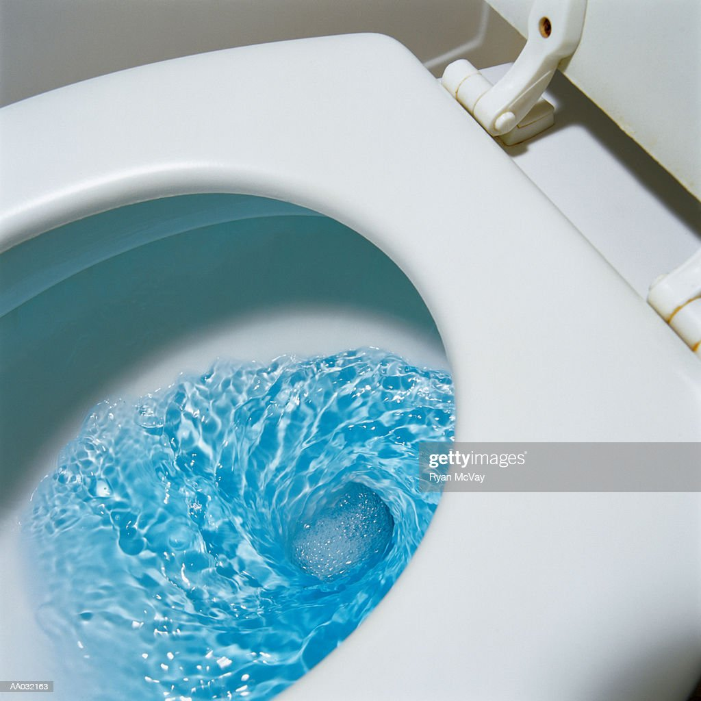 Flushing Toilet : Stock Photo