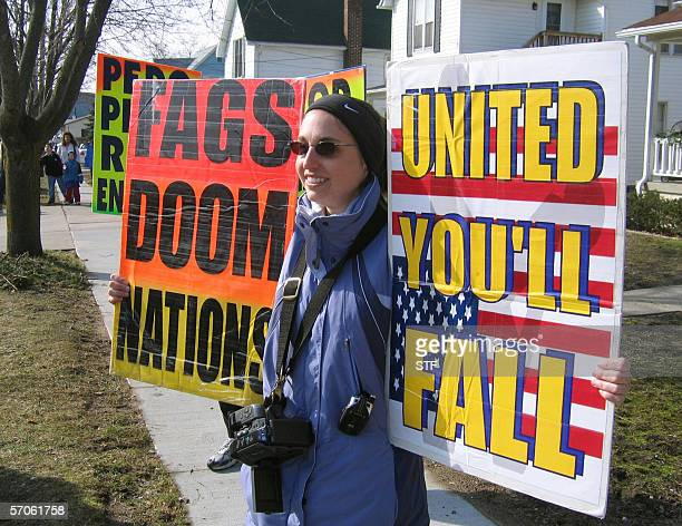 HECKLERS HARASS FAMILIES OF US SOLDIERS KILLED IN IRAQ Sara Phelps a member of the Kansasbased Westboro Baptist Church waves signs in front of a...