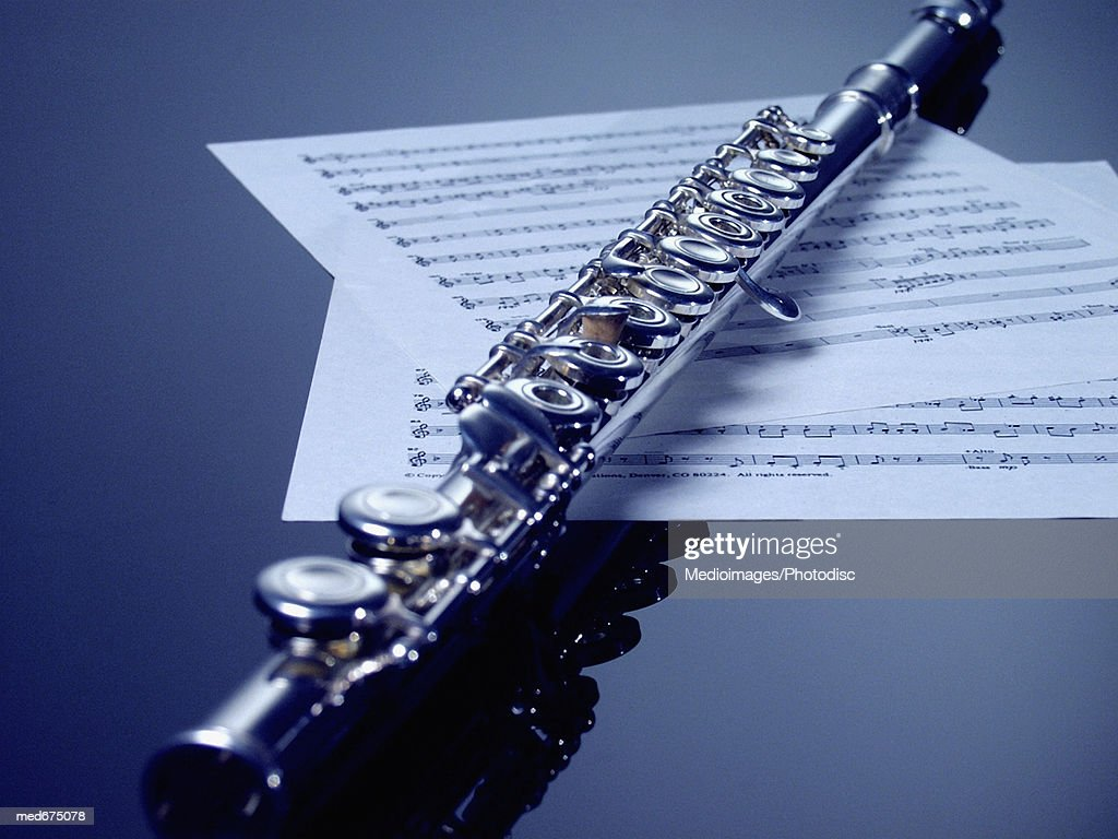 Flute On Sheet Music Closeup Stock Photo - Getty Images