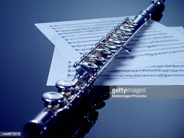 Flute on sheet music, close-up