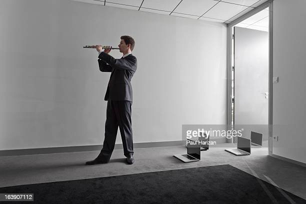 Flute player conducting laptops