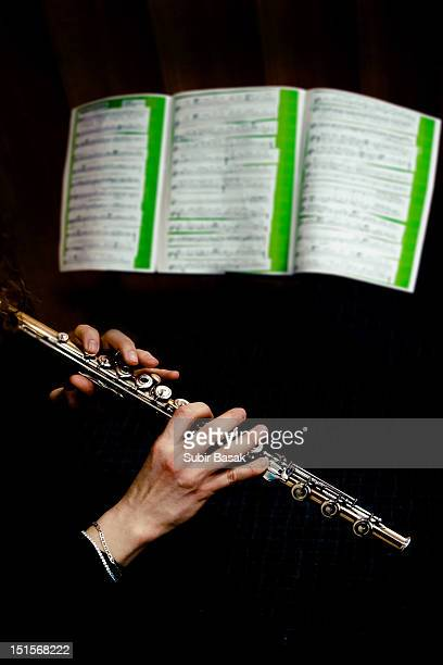 Flute Player perform infront of music sheet