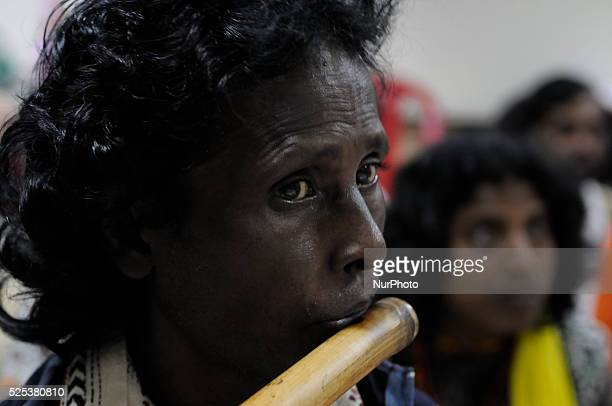 Flute player playing flute during a Baul workshop in Kolkata, India. The Bauls are an ancient group of wandering minstrels from Bengal, who believe...