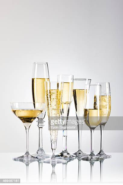 Flutes of Champagne on reflective glass