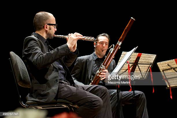 flutist and bassoonist during an italian concert - bassoon stock pictures, royalty-free photos & images