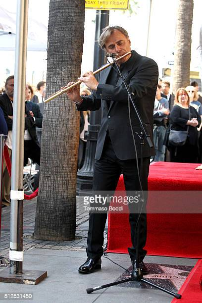 Flutist Andrea Griminelli attends a ceremony honoring composer Ennio Morricone wtih a star on The Hollywood Walk Of Fame on February 26 2016 in...