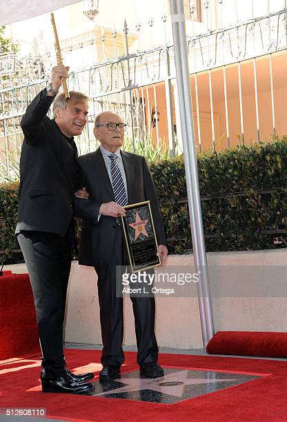 Flutist Andrea Griminelli with Ennio Morricone at the Ennio Morricone Star Ceremony On The Hollywood Walk Of Fame held on February 26 2016 in...