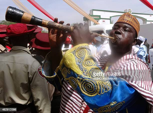 A flutist performs outside the Coronation Hall the venue of the investiture of Muhammadu Sanusi II as the 57th emir of the ancient Kano emirate on...