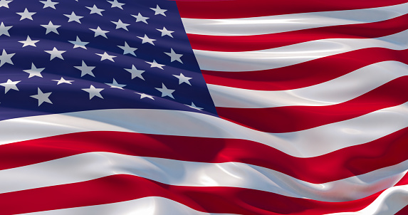 Fluttering silk flag of United States of America. Old Glory in the wind, colorful background 1133809617