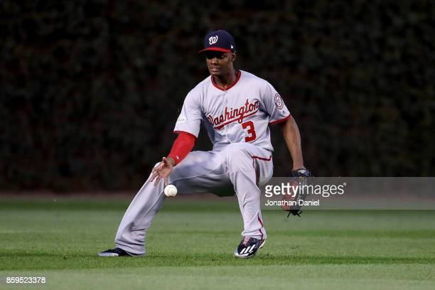 A fly ball drops in front of Michael A Taylor of the Washington Nationals in the eighth inning against the Chicago Cubs during game three of the...