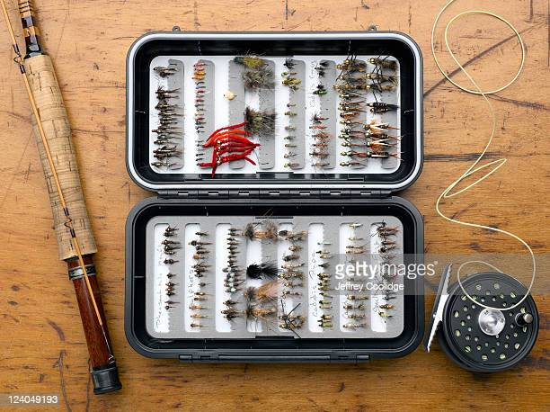 fly box, rod and reel - fishing tackle stock pictures, royalty-free photos & images
