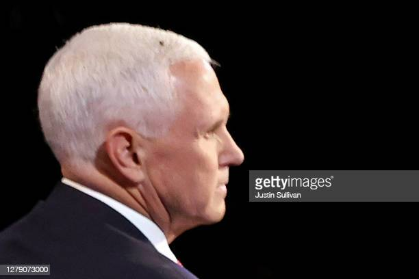 Fly briefly lands on head of U.S. Vice President Mike Pence during in the vice presidential debate against Democratic vice presidential nominee Sen....
