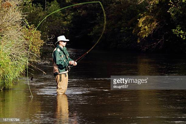 fly fisherman casting - big game fishing stock photos and pictures