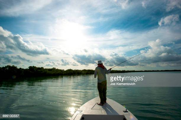 Fly fisherman casting to the shores of a mangrove island in Florida Bay.