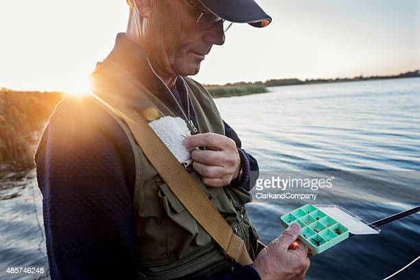 Fly Fisherman Choosing a Fly To Fish With