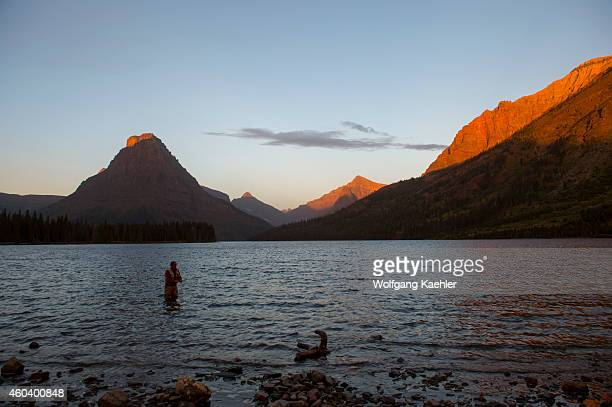 Fly fisherman early morning at Two Medicine Lake on the eastern edge of Glacier National Park Montana United States