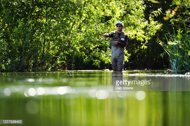 Fly fisherman Edward Crownshaw casts his line out as he fishes on the River Coln following a relaxation of the UK coronavirus lockdown conditions...