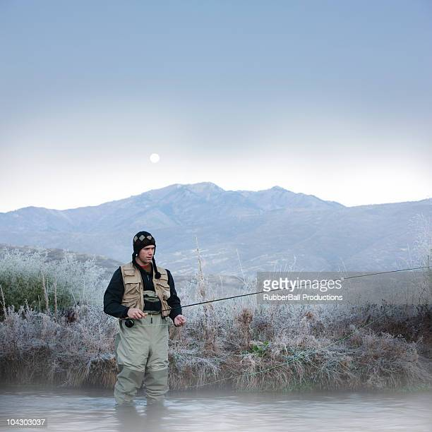 fly fisherman fishing in a mountain river - waders stock pictures, royalty-free photos & images