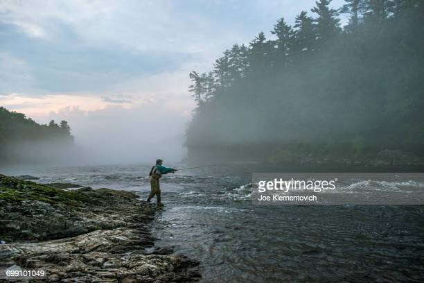 fly fisherman on the kennebec river, maine. - maine stock pictures, royalty-free photos & images