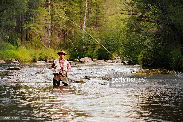 fly fisherman - fly casting stock pictures, royalty-free photos & images