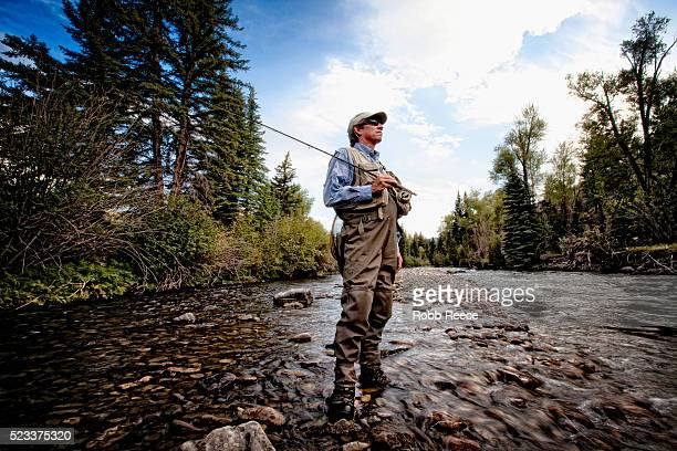 fly fisherman standing in stream in lake city, colorado - robb reece stock-fotos und bilder