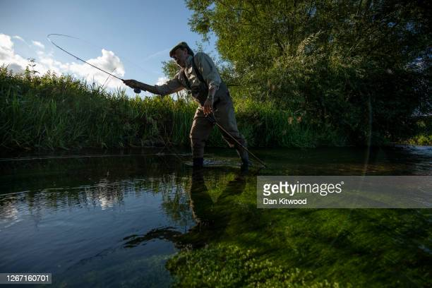 Fly fisherman takes on a section of the river Darent hoping to catch Brown Trout that they intend to return to the water on August 18, 2020 in...