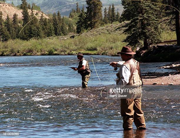 Fly fishermen casting in the Blue River just north of Silverthorne CO along Highway 9