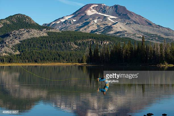 fly fishing at sparks lake - bend oregon stock photos and pictures