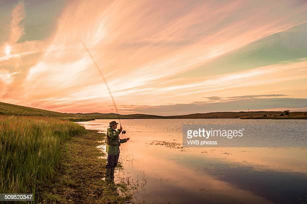 fly fishing at sunset, loch thom, clyde muirshiel - 淡水釣り ストックフォトと画像