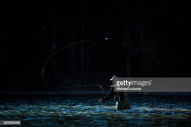 fly fishing in the river - fly casting stock pictures, royalty-free photos & images