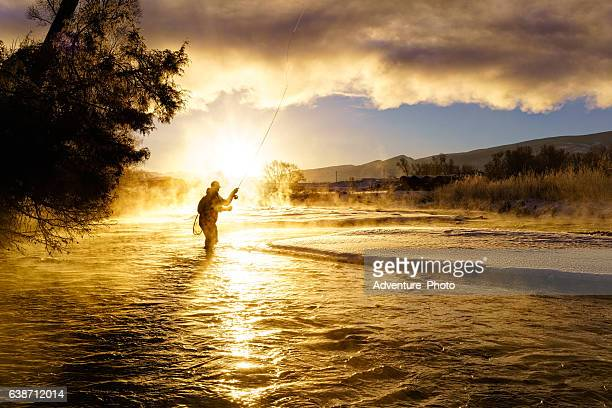 fly fishing in winter at sunrise - colorado stock pictures, royalty-free photos & images