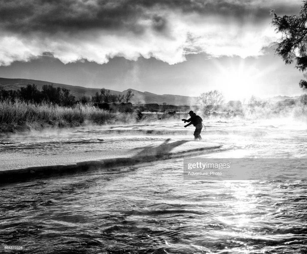 Fly Fishing in Winter at Sunrise : Stock Photo