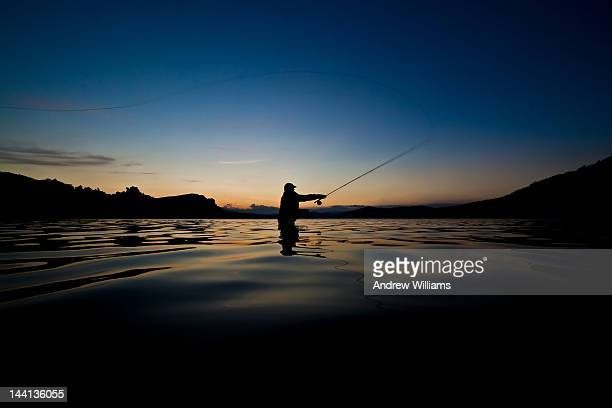 fly fishing lake waikaremoana - waist deep in water stock pictures, royalty-free photos & images