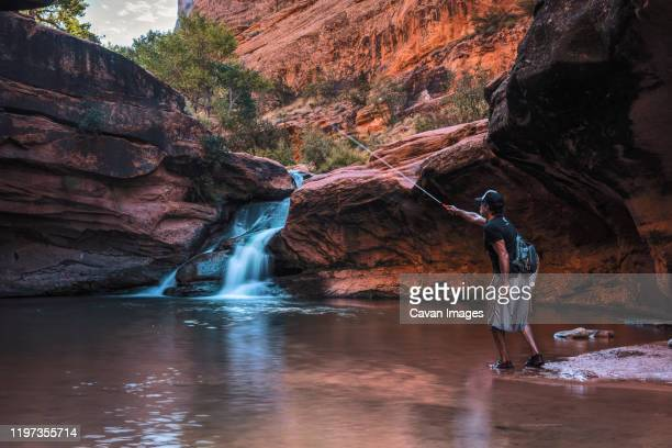 fly fishing on mill creek utah - moab utah stock pictures, royalty-free photos & images