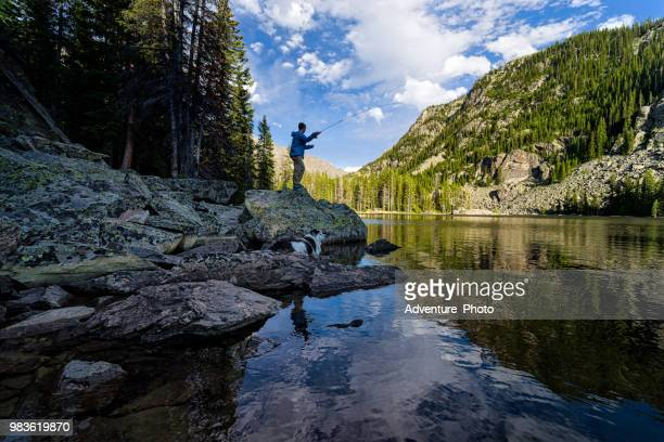 fly fishing on mountain lake - colorado stock pictures, royalty-free photos & images