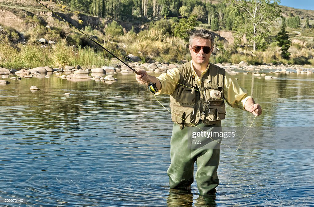 Fly fishing on the river : Stock Photo
