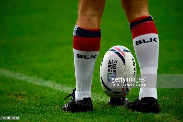 US fly half AJ MacGinty prepares to kick the ball during the captain's run training session at the Olympic stadium in London on October 6 2015 on the...